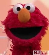 Elmo in Getting Dressed