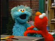 Rosita tickles Elmo in 3276
