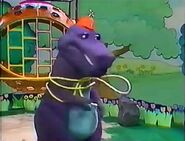 Barney spins as the backyard gang kids untie the rope off of him