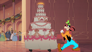 Goofy Arrives with a Cake