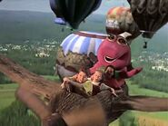 Barney and the Kids flying on a log airplane