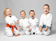 Cute-Karate-Kids-Kneeling-