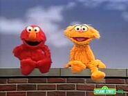 Elmo tickling himself during Zoe Says game