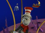 The Cat in the Hat rides in a hot air balloon during the theme song