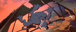 Spike and the wolf fall through a hole of the bridge