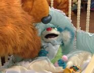 Bear tickles baby Treelo