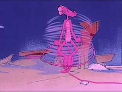 Pink panther plays with a string.jpg