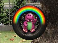 A Barney doll from seasons 2-3 winks