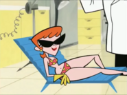Dexter's Mom is in a chair.