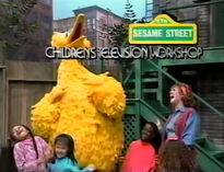 Ruthie, Big Bird and the kids laugh in different ways and Ruthie struggles to annouce the closing sponsors with laughter