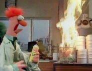 Beaker lights a torch fire on a trashcan