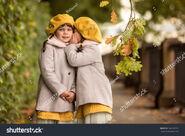 Stock-photo-the-girl-whispers-her-sister-a-secret-in-her-ear-family-secrets-secrets-of-girls-745387651