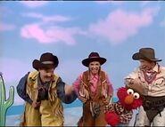 Cowboy Elmo dances with the Noodles