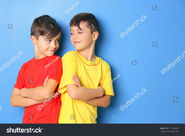Stock-photo-twin-brothers-on-blue-background-579768982