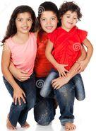 Three-caucasian-kids-two-girls-one-boy-all-wearing-blue-jeans-wearing-orange-red-pink-shirts-34175550
