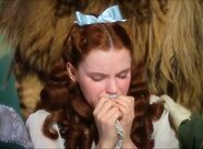 Dorothy cries because she misses her Auntie Em