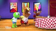 Rizzo eats pizza that Kermit and Fozzie made
