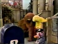 Big Bird and Snuffy fall asleep as Barney the mail carrier arrives