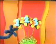 Grover's hands in Noggin's 123 Sesame Street bumper