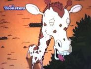 Giraffe Browsing and Watching Over a Herd.JPG