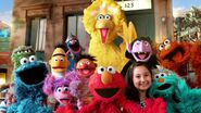 Sesame Street Muppets and a Girl in the season 46 opening sequence