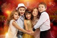 65934499-group-of-happy-kids-in-holiday-clothes-with-fireworks-on-background-holidays-christmas-new-year-x-ma
