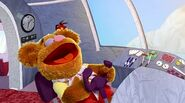 Fozzie laughs at jokes while flying the plane