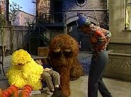 Big Bird, Snuffy and Bob are sound asleep in front of Hooper's Store in the beginning of episode 2795