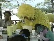 Big Bird, Mickey, Rusty and the rest of the campers resting at the dinner table