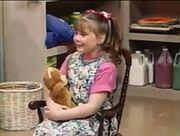 Kathy sings about her teddy bear.jpg