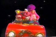 Barney and the backyard gang kids take off on a magic sleigh to the north pole singing, Jingle Bells