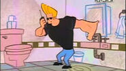 Johnny Bravo chats on the phone.