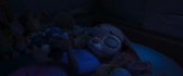 Judy looks at her bunny toy