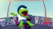Animal makes Kermit spin around in his pilot seat
