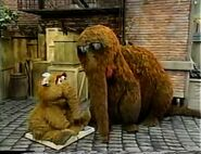 Snuffy gets angry at Alice because she won't get off his book