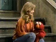 Gina tickling Elmo in the beginning of episode 3121