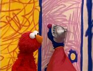 Super Grover naps on Elmo's door