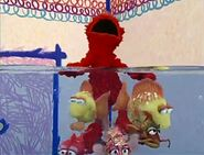 The fishes tickling Elmo