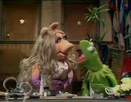 Kermit is mad at Miss Piggy and threatens to fire her
