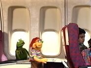Kermit, Lindy and the kids taking a flight on a jetplane