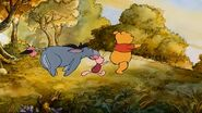 Pooh, Piglet and Eeyore getting chased by the bees
