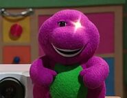 A current Barney doll from season 7 winks