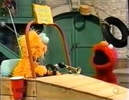 Elmo gets mad at Zoe because she won't share her Zoemoblie with him