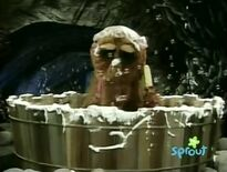 Snuffy takes a bath and the suds tickle him