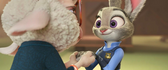 Judy smiles at bellwether holding hands
