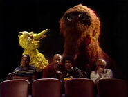 Big Bird, Snuffy and the adults at the movies in episode 1034