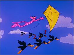 Pink panther flies a kite with ducks flapping.jpg