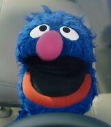 Grover in Listen, Drive, Surprise!