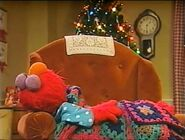 Elmo falls asleep while waiting for Santa Claus
