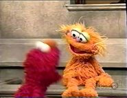 Elmo gets mad at Zoe for calling him a rotten egg and a rotten potato chip